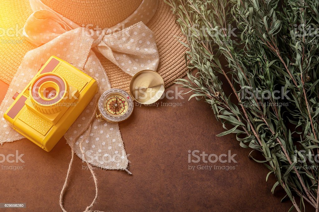 summer travel concept with yellow toy camera stock photo