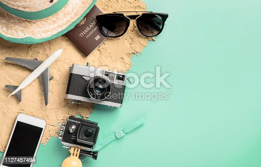 665586146 istock photo Summer travel fashion and accessories travel top view flatlay on blue teal pastel 1127457494
