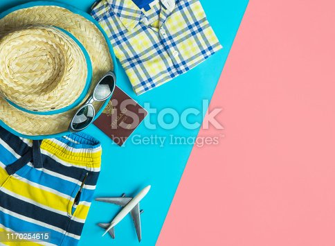 665586146 istock photo Summer travel fashion and accessories travel top view flatlay on blue yellow pink 1170254615