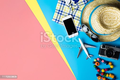 665586146istockphoto Summer travel fashion and accessories travel top view flatlay on blue yellow pink 1170553809