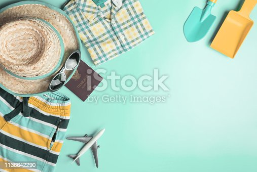 665586146 istock photo Summer travel fashion and accessories travel top view flatlay on teal pastel 1136642290