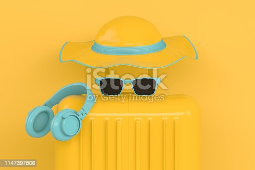istock Summer, Travel Minimal Concept, Hat and Suitcase on Yellow Background 1147397806
