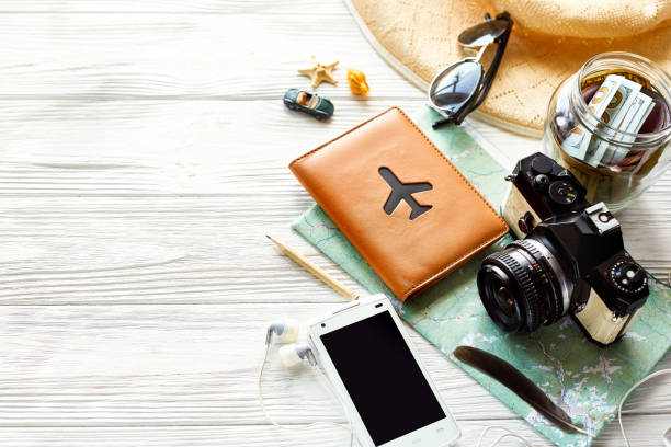 summer travel wanderlust concept, space for text. map camera sunglasses  passport money phone with empty screen hat shells car toy on white wooden background. hello holiday, planning vacation - phone, travelling, copy space imagens e fotografias de stock