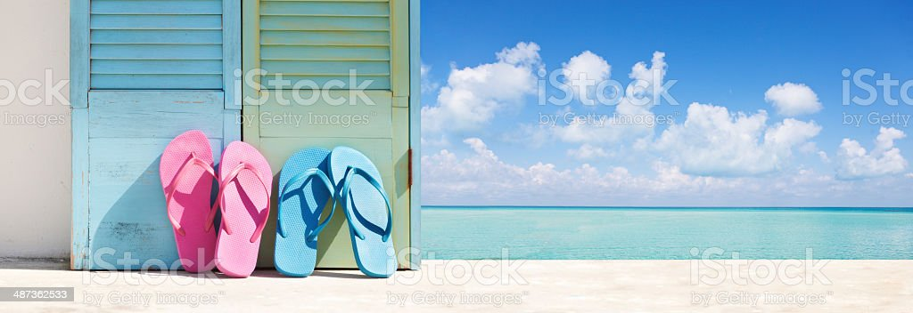 Summer Tropical Beach Vacation Flip-flops Sandals Couple by Caribbean Sea stock photo