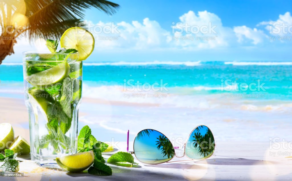 summer tropical beach wine bar; mojito cocktail drink stock photo