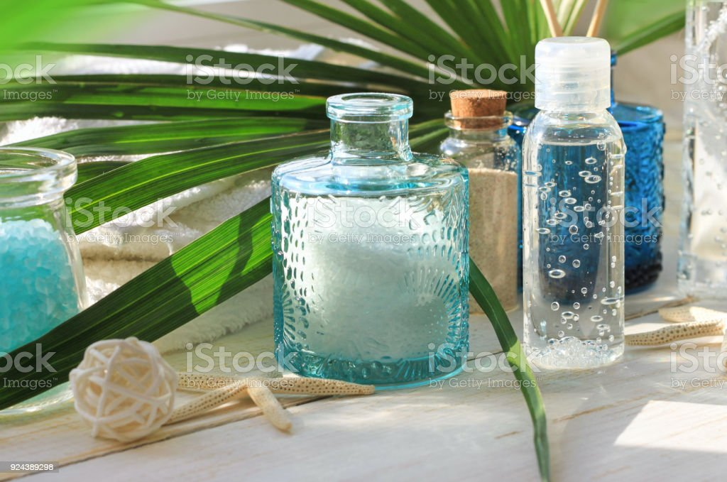 Summer tropical spa body and beauty treatment set on sunny bathroom shelf. stock photo