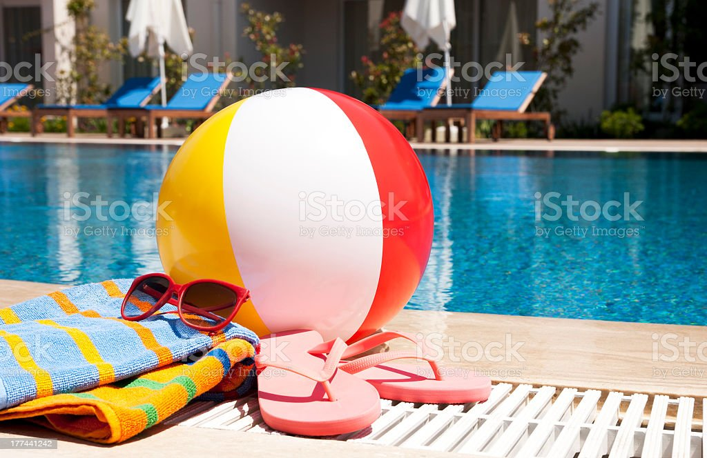 Summer vacation accessories by a pool stock photo