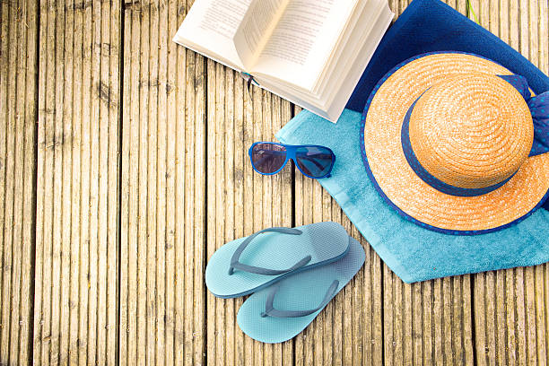 summer vacation, accessories for beach holidays on wooden planks stock photo