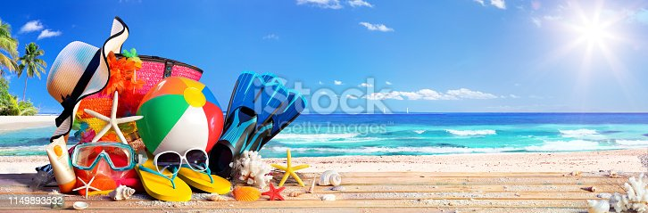 istock Summer Vacation - Accessories On Deck In Tropical Beach 1149893532