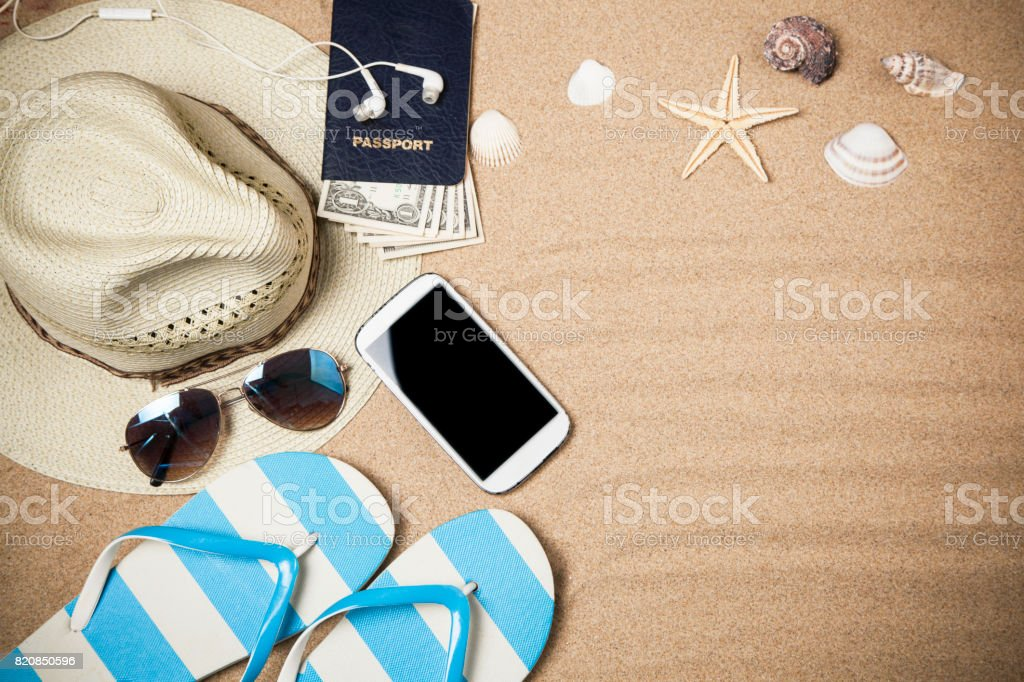 Summer vacation accessories  on sand stock photo