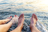 Vacation. legs close-up resting on the beach of the sea, enjoying the sun. travel concept
