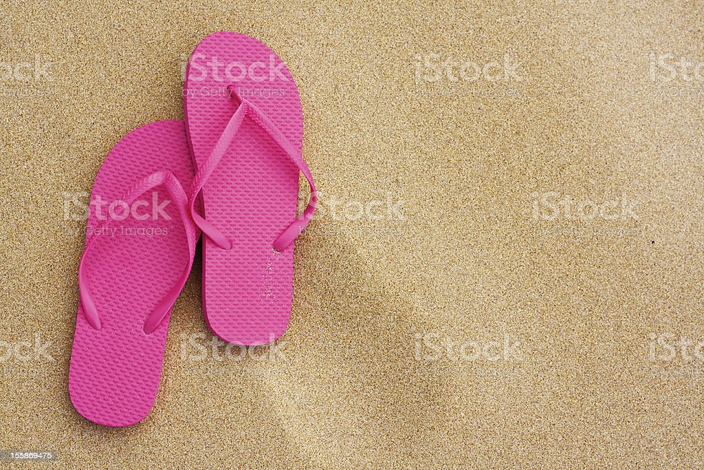 Summer vacation background sandals on beach royalty-free stock photo