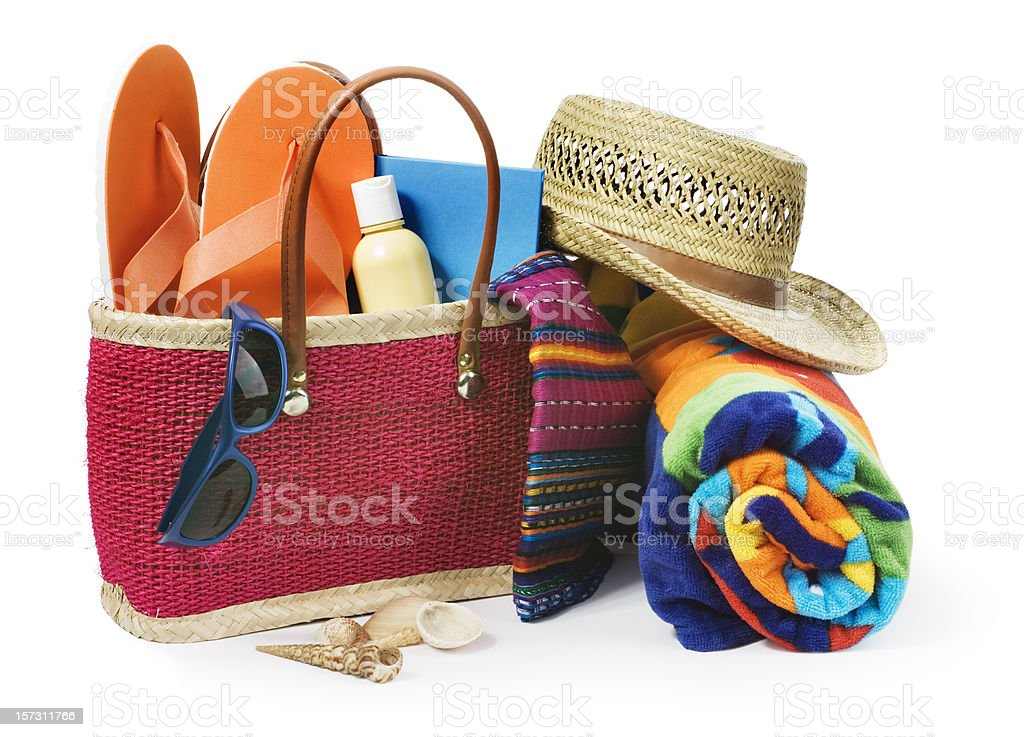 Summer Vacation Beach Bag with Supplies Isolated on White Background royalty-free stock photo