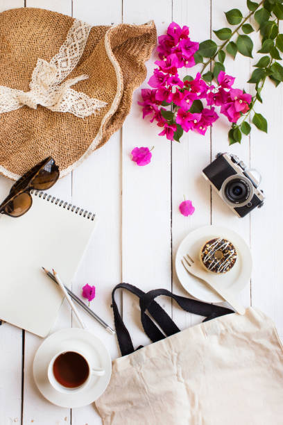 Summer vacation coffee break objects concept image. Summer travel vacation planning, coffee break and objects on white table top. pasport malaysia stock pictures, royalty-free photos & images