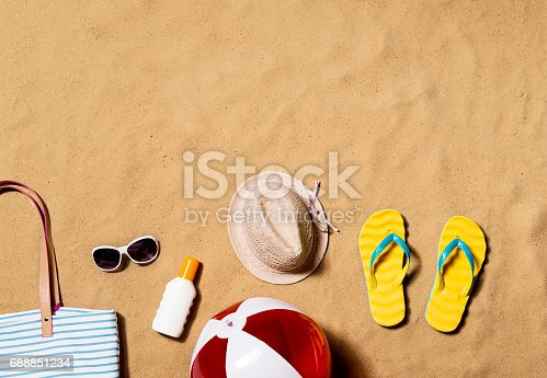istock Summer vacation composition. Flip flops, hat and other stuff 688851234