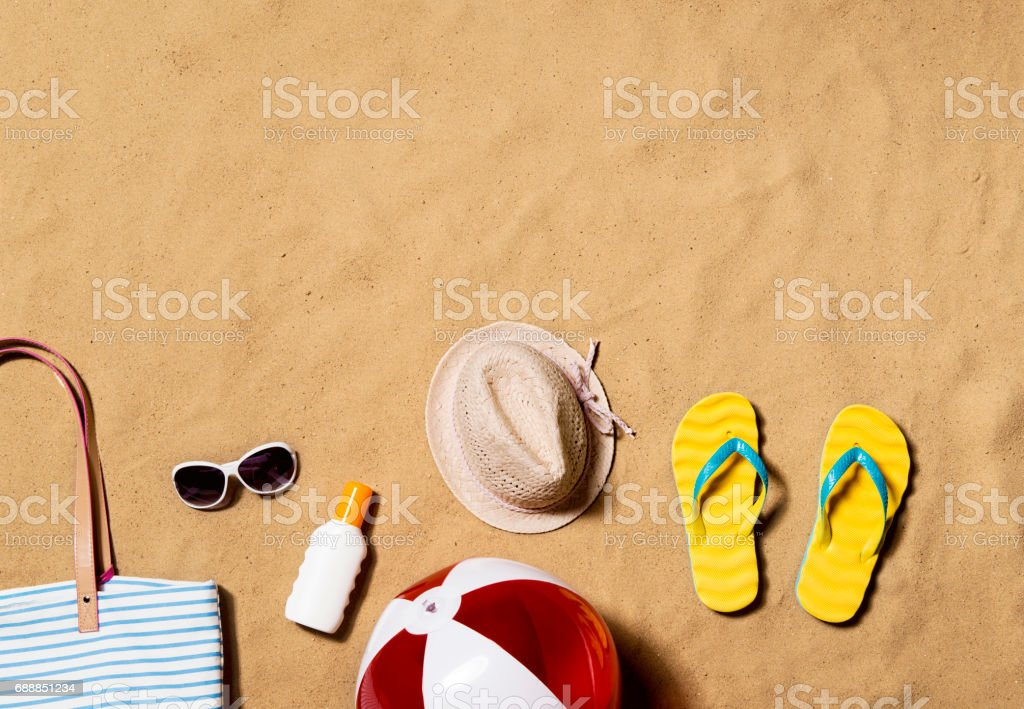 Summer vacation composition. Flip flops, hat and other stuff stock photo