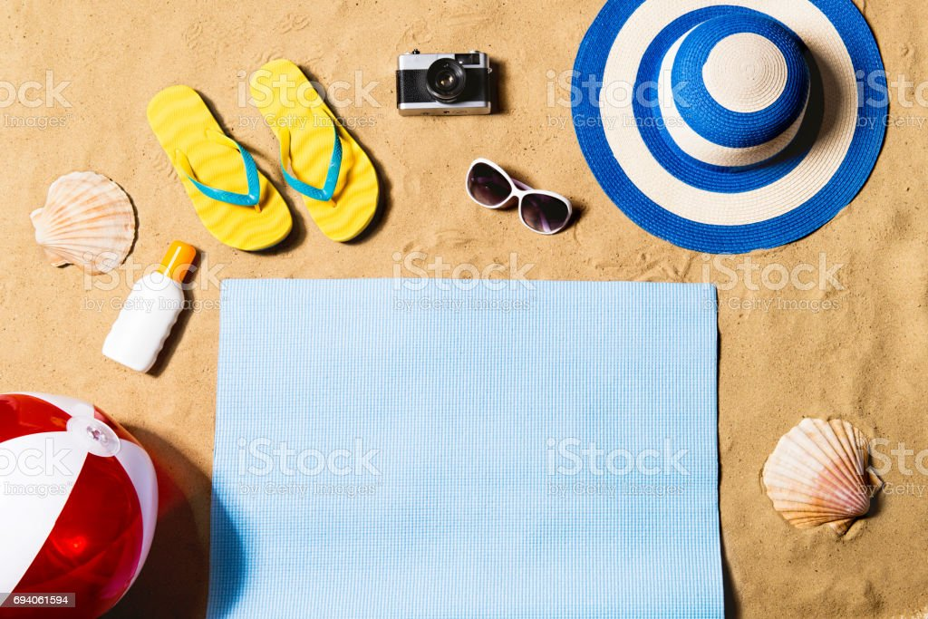 Summer vacation composition. Sandals, hat and beach ball. stock photo