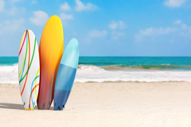 Summer Vacation Concept. Colorful Summer Surfboards on an Ocean Deserted Coast. 3d Rendering Summer Vacation Concept. Colorful Summer Surfboards on an Ocean Deserted Coast extreme closeup. 3d Rendering lesser sunda islands stock pictures, royalty-free photos & images