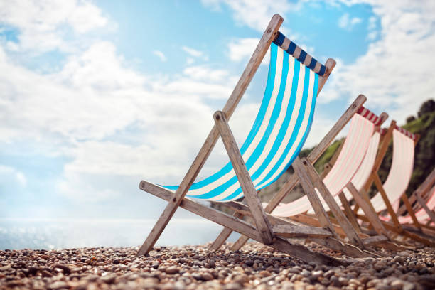 Summer vacation deck chair on the beach at the seaside stock photo