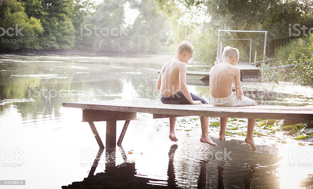 Summer vacation, friends at the lake stock photo