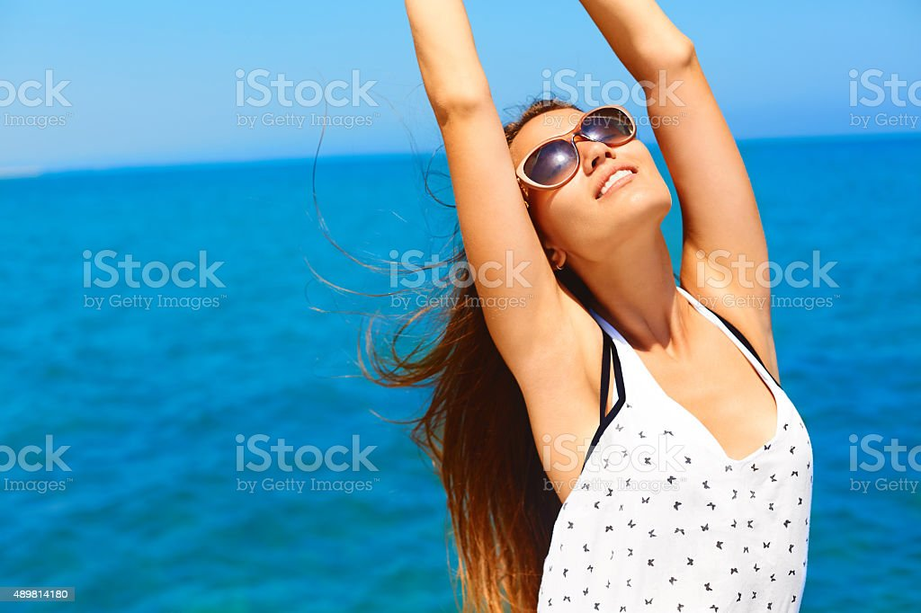Summer vacation. Happy woman enjoying the sun. stock photo