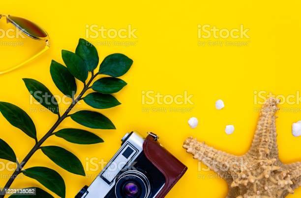 Summer vacation holiday concept on yellow background picture id1223138082?b=1&k=6&m=1223138082&s=612x612&h=hu4rqqavthcdq03g js11lutlyx3d6pn7eeeh8kti2c=