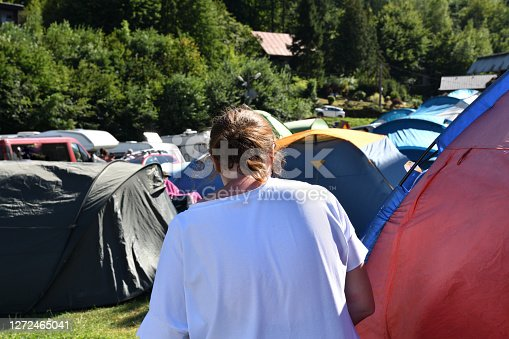 Woman on vacation looking around a tent town