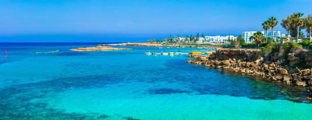 summer vacation in cyprus island. protaras , fig tree bay - cyprus стоковые фото и изображения