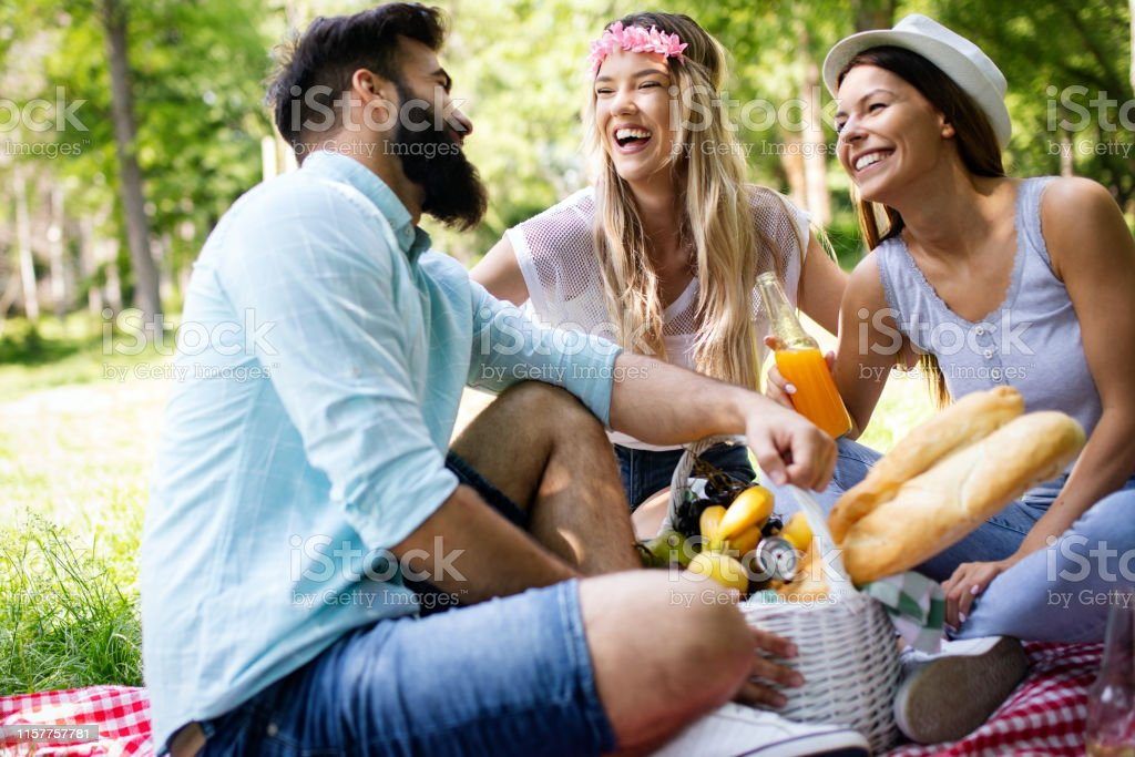 Summer, vacation, music and recreation time concept. Cheerful friends...