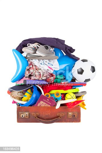 istock summer vacation or holiday suitcase really packed, cannot close 153496425