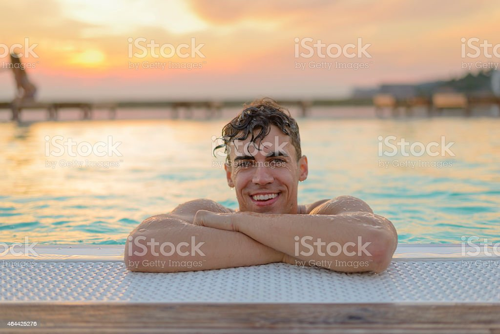 Summer Vacation Young Man Outdoors Swimming Pool royalty-free stock photo