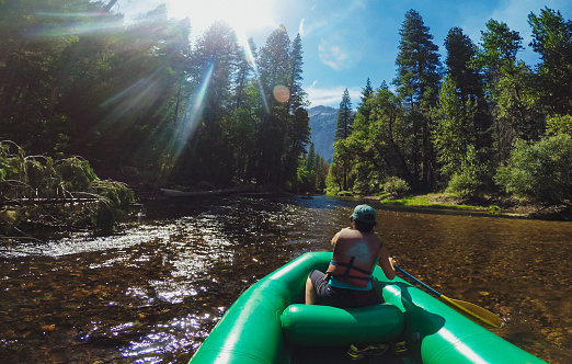 POV of a woman rafting in Merced River of Yosemite