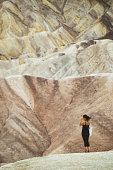 Summer vacations in California: woman at Death Valley National Park, Zabriskie Point