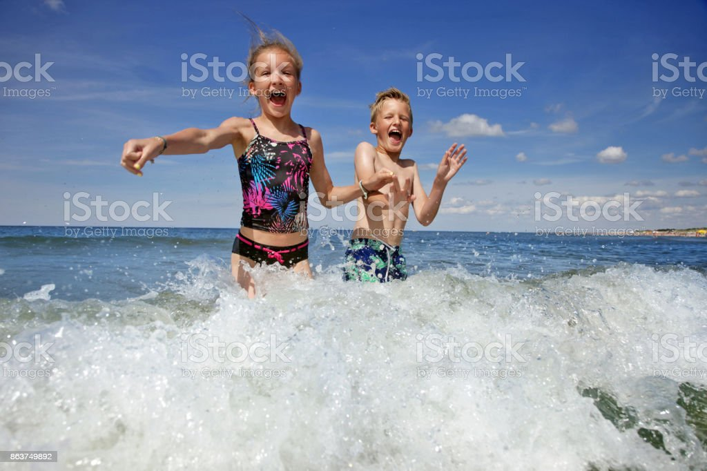 Summer vacations - kids jumping into the sea