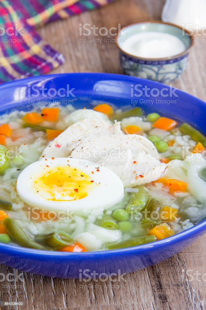 Summer vegetable soup with cabbage, beans, chicken, egg, tasty healthy dish for the diet, kids lunch royalty-free stock photo