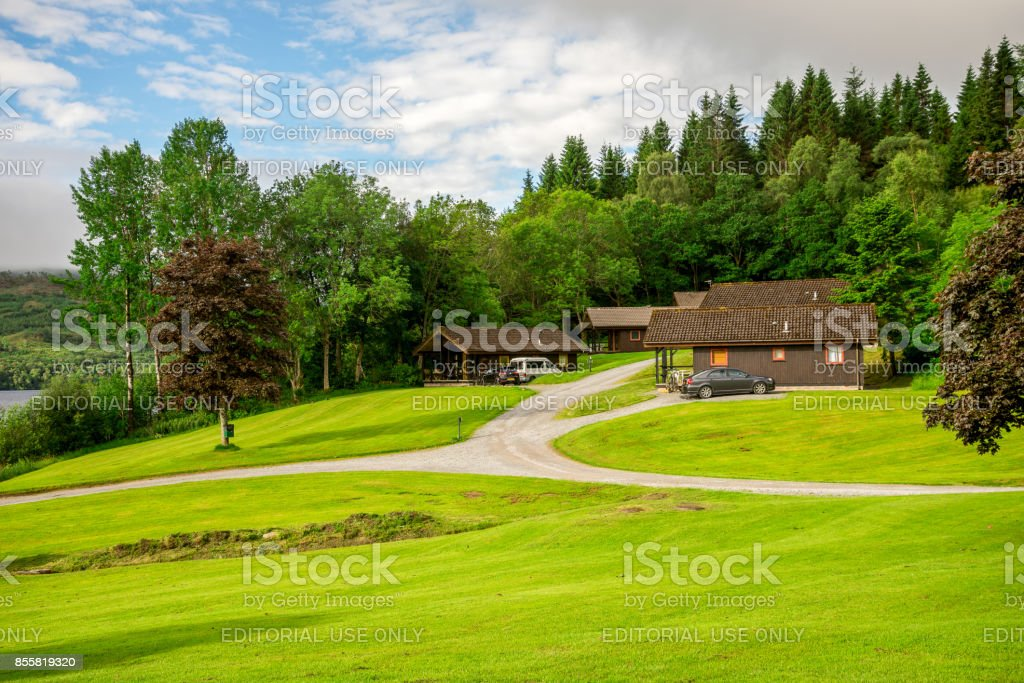 Summer view of holiday lodges on the banks of Loch Tay lake in central Scotland, Great Britain stock photo