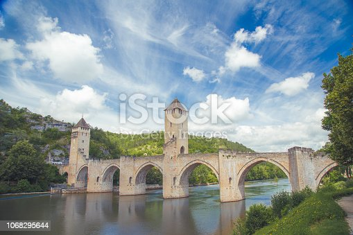 istock Summer view of medieval stone Valentre Bridge with blu sky in Cahors, France 1068295644