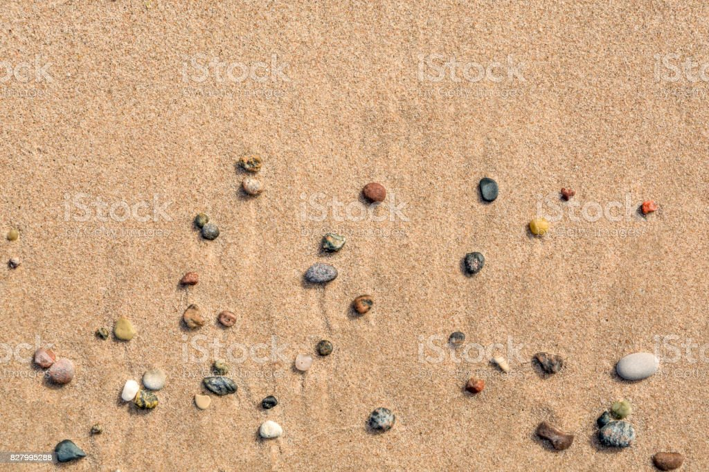 Summer view of small round pebbles on sunny beach, seen from above. royalty-free stock photo