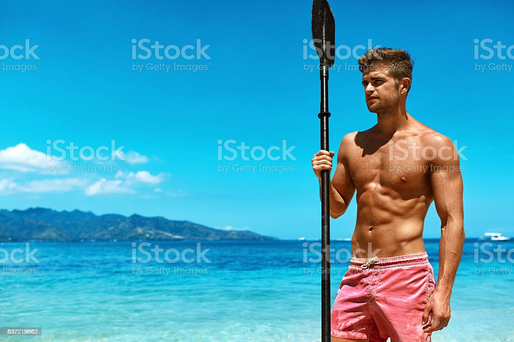 Summer Water Sport. Handsome Athletic Man With Sexy Body In Swimwear...