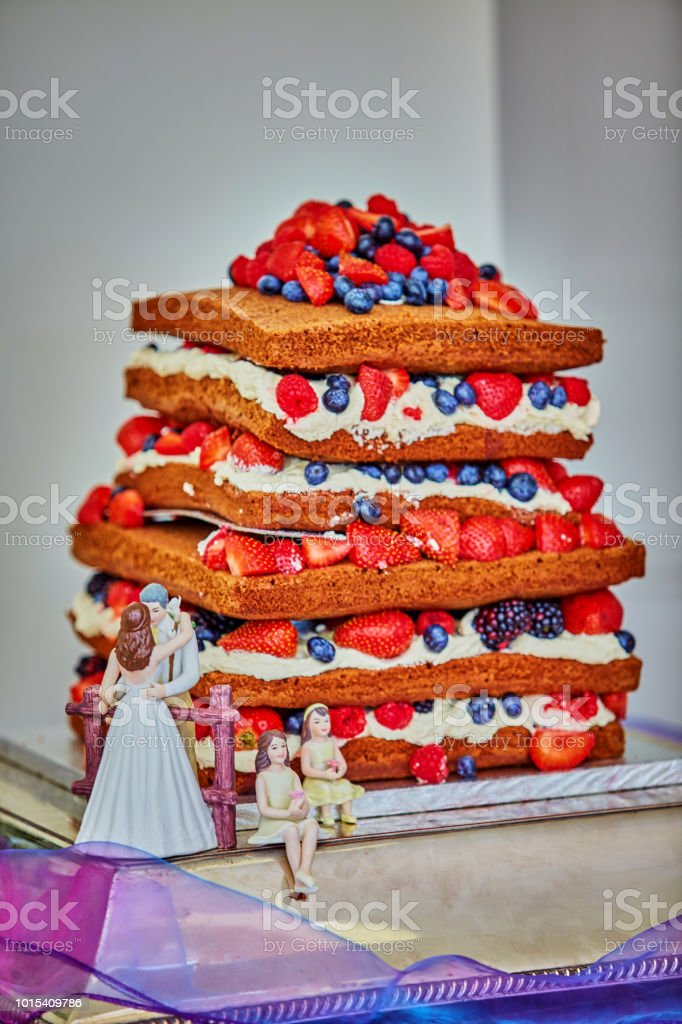 Summer wedding cake a traditional victoria sponge tiered cake with...