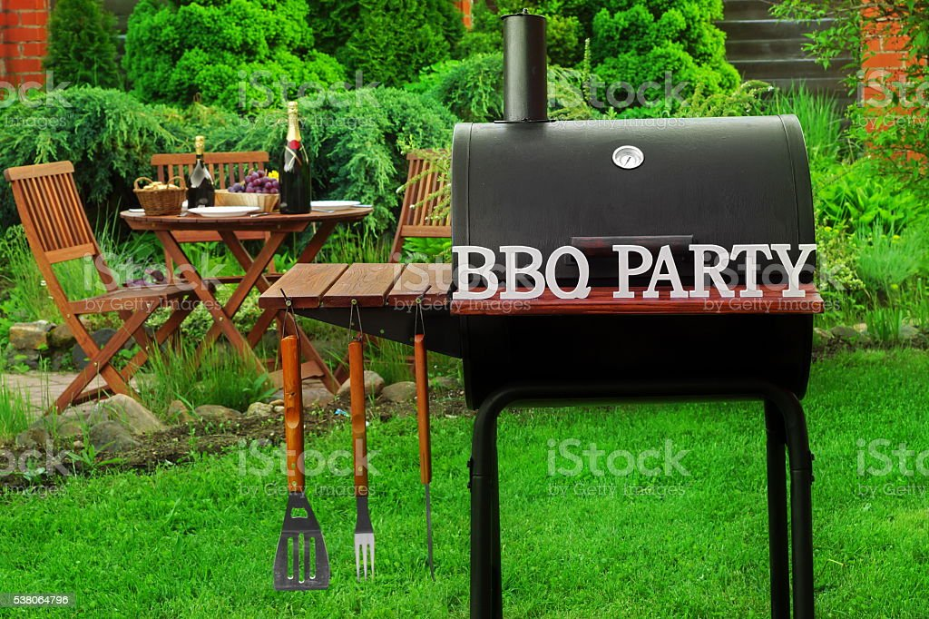 Summer Weekend BBQ Scene With Charcoal Grill On The Backyard stock photo
