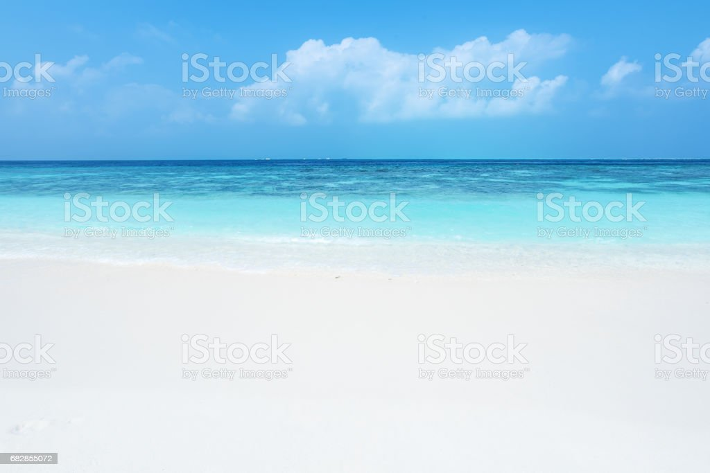 Summer white sandy beach and tropical sea background stock photo