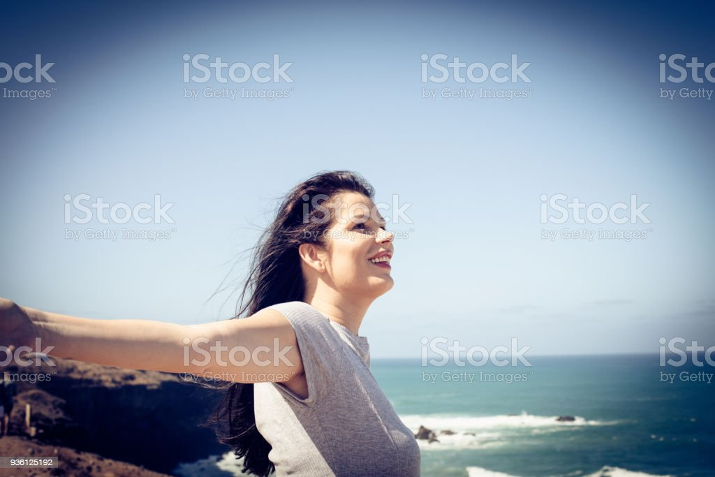 Summer wing in hair make me happy. Young woman. stock photo