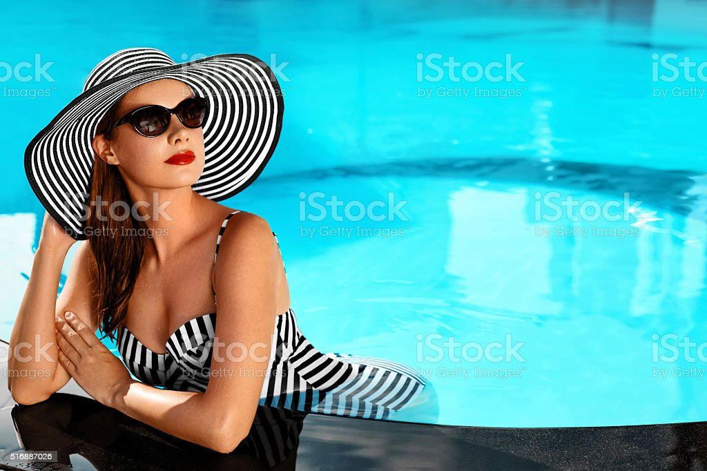 Summer Woman Beauty, Fashion. Healthy Woman In Swimming Pool. stock photo