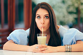 istock Summer Woman Drinking Fruit Juice in a Restaurant 1149589124