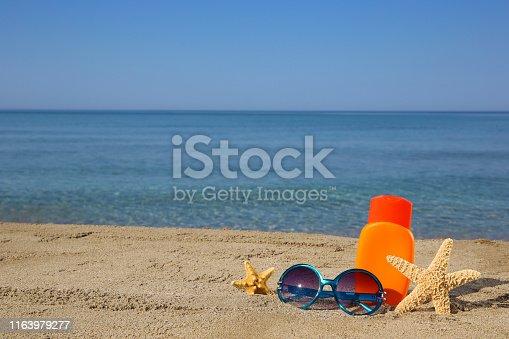Summer women's accessories on the beach.