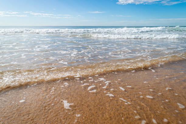 Summer_beach_waves_shallow_shore stock photo
