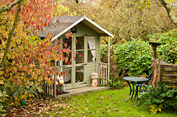 Summerhouse Autumn leaves are  falling in the gardenand and the summerhouse is closed up for another year shed stock pictures, royalty-free photos & images