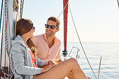 Shot of a young couple enjoying a cruise out on the ocean