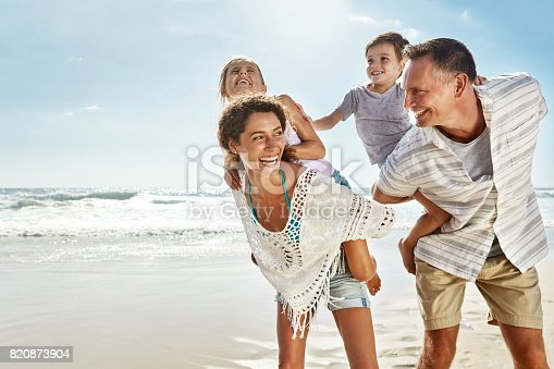 Shot of a family enjoying some quality time together at the beach
